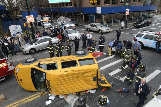Four were injured when a school bus flipped after slamming into a vehicle on Atlantic Avenue in Cobble Hill. Photo: ##http://www.nydailynews.com/new-york/brooklyn/school-bus-accident-injures-4-brooklyn-article-1.1538809##Daily News##