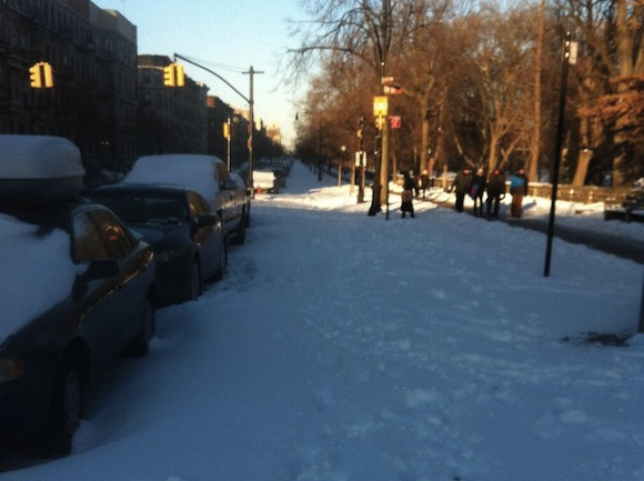 While some protected bike lanes have been cleared, the Prospect Park West bike lane remains covered in snow. Photo: Alex Knight/Twitter