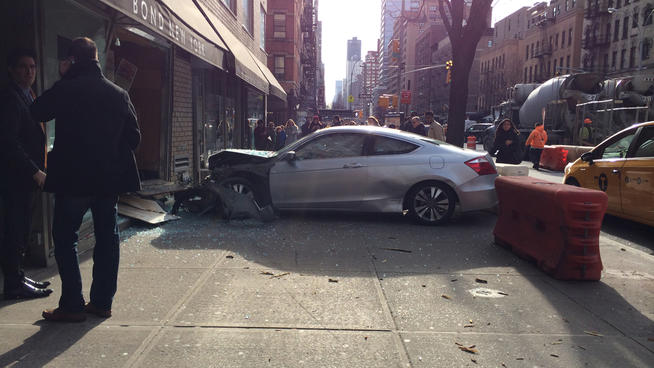 A driver jumped a curb on the Upper East Side, crashing into a storefront and injuring two passengers. No charges were filed. Photo: ##http://www.nbcnewyork.com/news/local/Upper-East-Side-Car-Crash-Window-Storefront-Second-Avenue-241185961.html##WNBC##