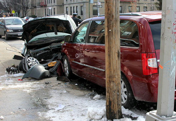 A driver who crashed head-on into a parked car in Astoria was found to have been driving under the influence of heroin and with a suspected license. Photo: ##http://timesledger.com/stories/2014/5/astoriacollision_web_2014_01_31_q.html##Times Ledger##