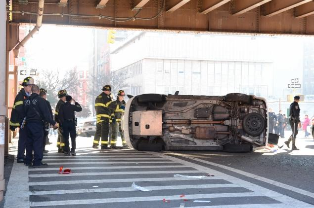 Two police vehicles collided in Harlem, one overturning, leaving two officers with minor injuries. Photo: ##http://www.nydailynews.com/new-york/uptown/2-police-vehicles-collide-harlem-article-1.1577978##DNAinfo##