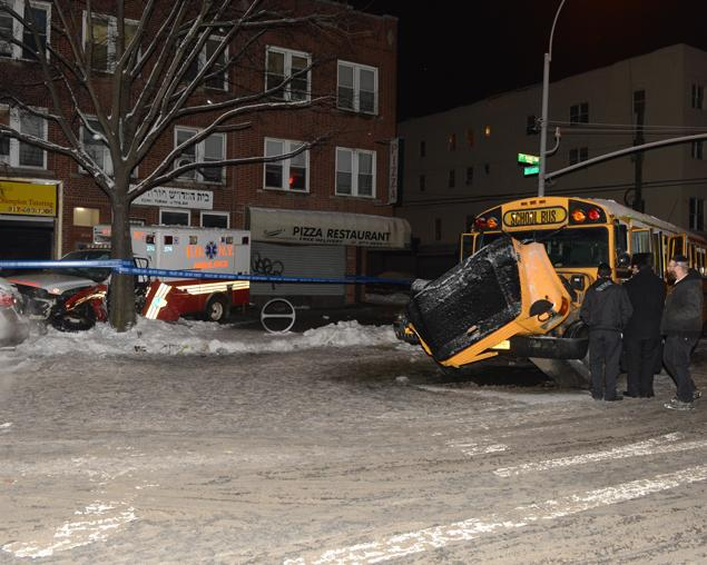 Nineteen people were injured, three seriously, when an ambulance crashed into a school bus in Borough Park. Photo: ##http://www.nydailynews.com/new-york/brooklyn/ambulance-crashes-bus-brooklyn-injuring-school-children-officials-article-1.1608072##Daily News##