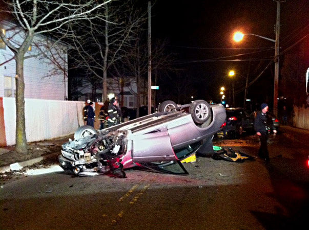 A car crash in Great Kills knocked over a fire hydrant, flooding the street. Photo: ##http://www.silive.com/news/index.ssf/2014/02/car_crash_takes_out_hydrant_in.html##SI Advance##