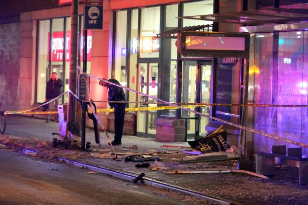 A hit-and-run driver crashed into a bus stop in Woodside, injuring four, including a 7-year-old girl. Photo: ##http://www.dnainfo.com/new-york/20140202/woodside/7-year-old-girl-hurt-with-three-others-hit-and-run-at-queens-bus-stop##DNAinfo##