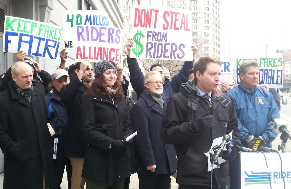 John Raskin of Riders Alliance speaks with some of the 32 Assembly members who signed a letter urging Speaker Sheldon Silver to take Governor Cuomo's transit raid out of the state budget. Photo: Stephen Miller