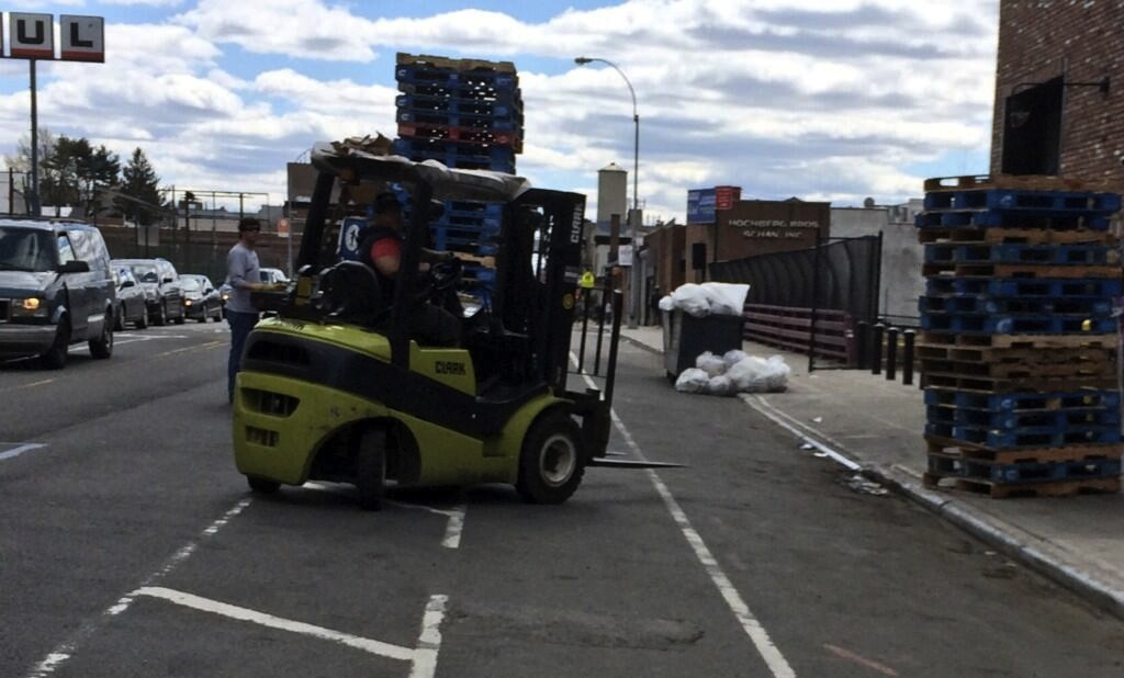 Who needs newly-built loading docks when you can take over the sidewalk and the bike lane? Photo: Brooklyn Spoke/Twitter