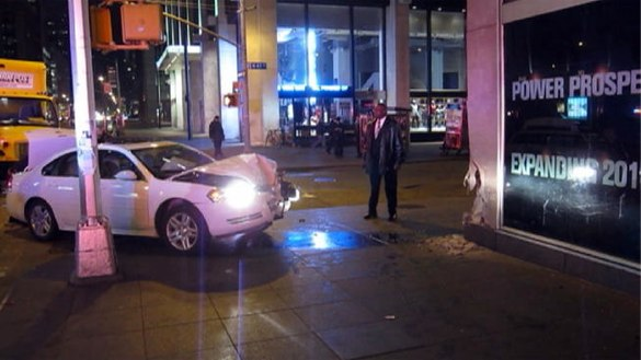 A motorist drove onto the sidewalk and hit the News Corp. building in Midtown. Five people were injured, two seriously. Photo: WNBC