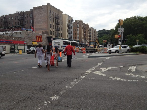 DOT extended a pedestrian island that separates north- and southbound lanes on Riverside Drive at Broadway and Dyckman Street, adding space for pedestrians and forcing drivers to slow their turns. Photos: Brad Aaron