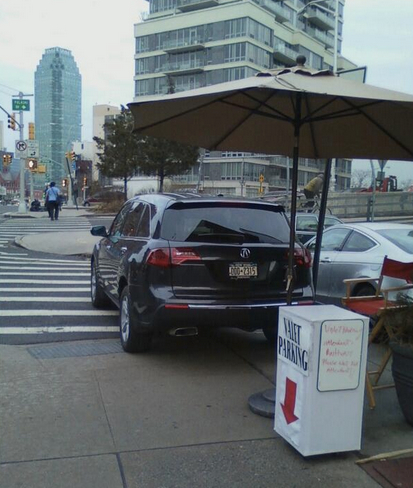 Manetta's Restaurant in Long Island City takes over the sidewalk and the access ramp for valet parking. Classy. Photo: ##https://twitter.com/alter_spaces/status/449690329835249664/photo/1##@alter_spaces##