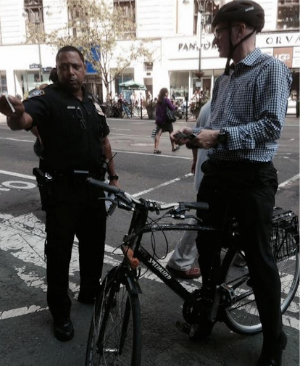 Ticketing more cyclists won't make streets safer. Photo via ##https://twitter.com/OpSafeCycle/status/502490308798459905/photo/1##@OpSafeCycle##