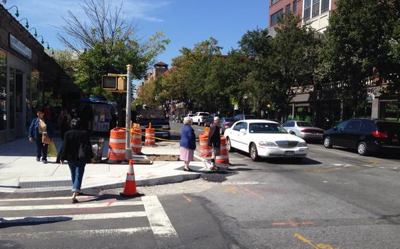 New curb extensions are popping up on 37th Avenue in Jackson Heights. Photo: Clarence Eckerson Jr.
