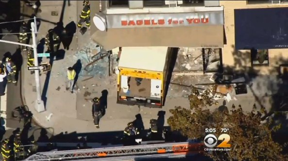"A motorist drove a truck through a bagel shop on Queens Boulevard in Forest Hills, injuring five people inside, including an infant. NYPD: ""No criminality suspected."" Image: CBS 2"
