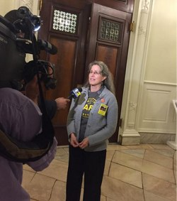Amy Cohen, whose son Sammy Cohen Eckstein was killed by a motorist last year, speaks to the media after today's City Council vote to lower the default city speed limit to 25 mph. Photo: ##https://twitter.com/killercatch/status/519562268363612162/photo/1##Caroline Samponaro/Twiiter##
