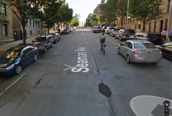 Rough street surface and barely visible bike lanes on the southern end of Seaman, which DOT has not repaved. Image: Google Maps