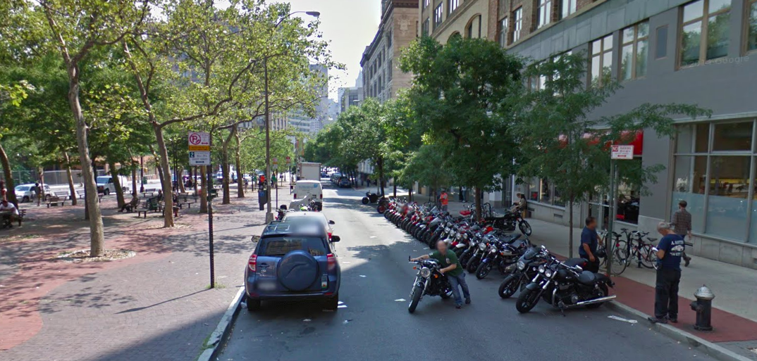 The plaza on the left is getting refurbished, but a shared space plan for this street was tabled in part because it's used as a display space for a motorcycle dealership. Photo: Google Maps