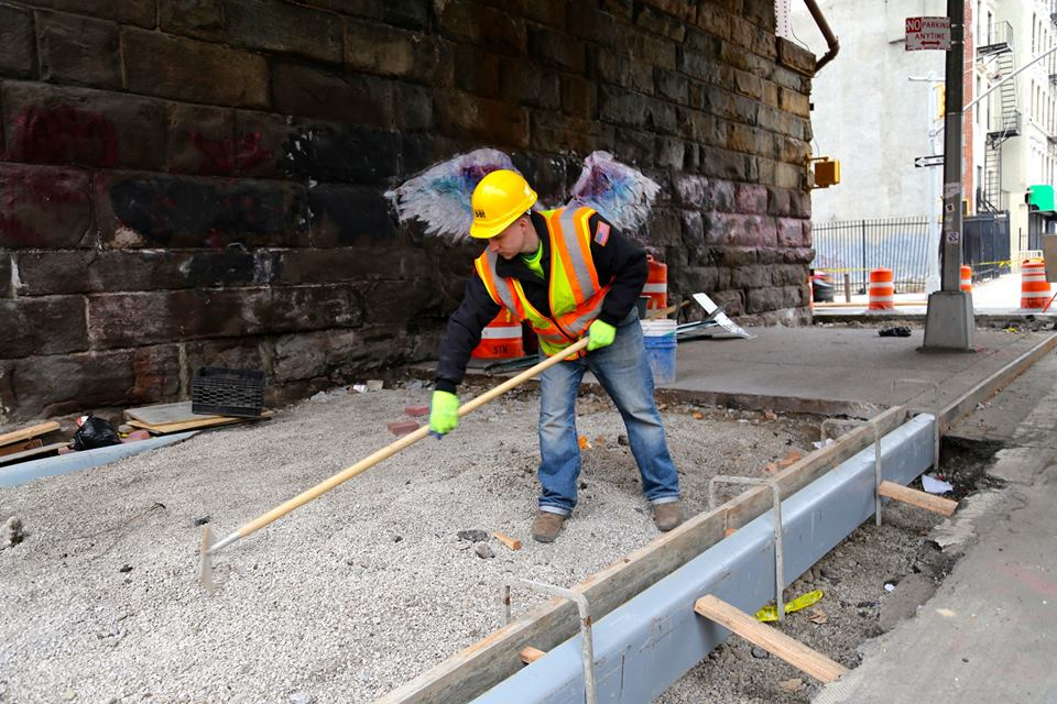 Crews install a concrete neckdown at Park Avenue and 111th Street. Photo: NYC DOT/Facebook