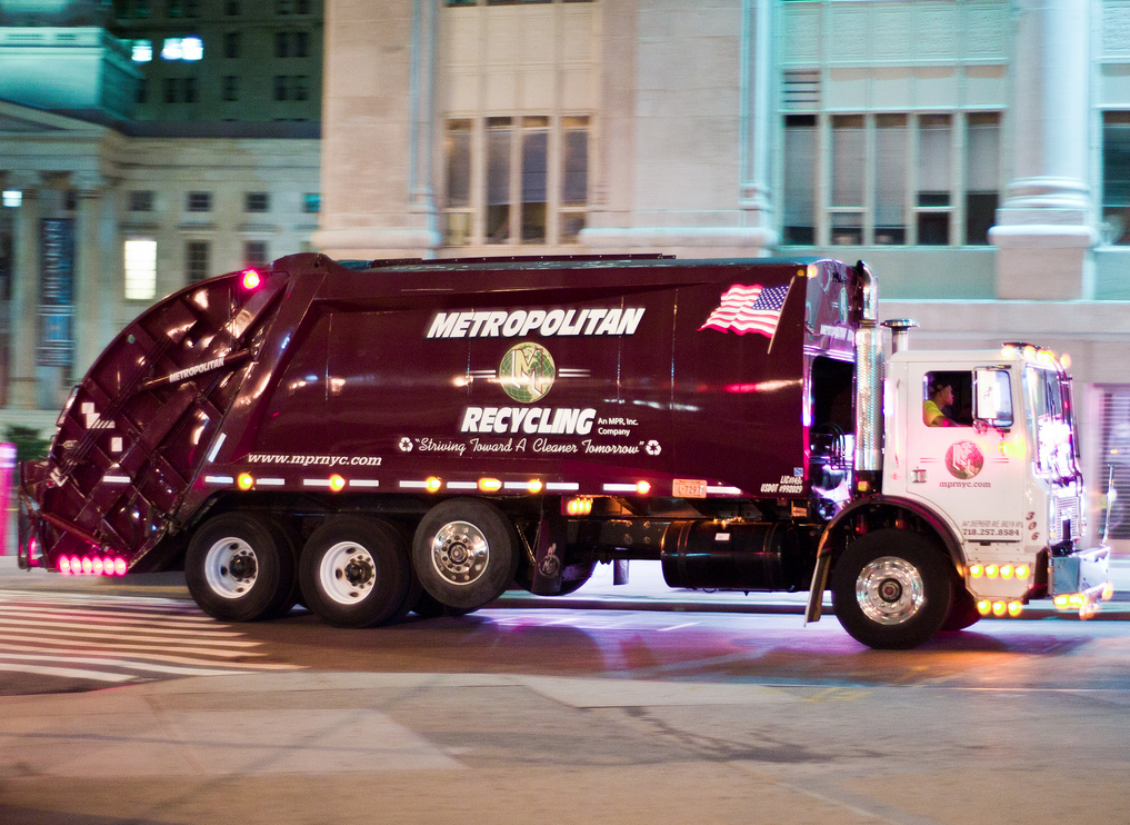 Under a City Council bill likely to pass tomorrow, city-owned and private trash trucks would be required to have side guards to protect fallen pedestrians and cyclists. Photo: Douglas Palmer/Flickr