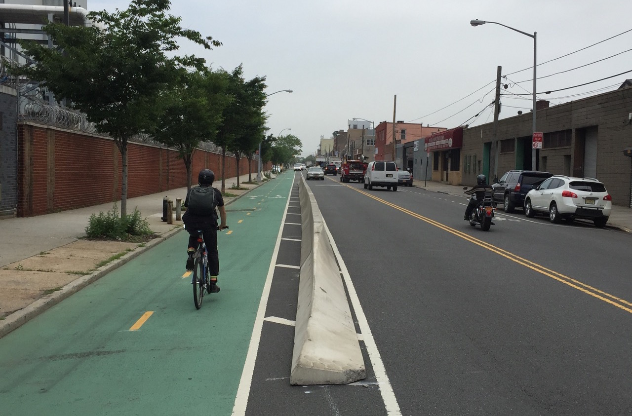 New concrete barriers are being added to Vernon Boulevard in Queens. Photo: Clarence Eckerson Jr.