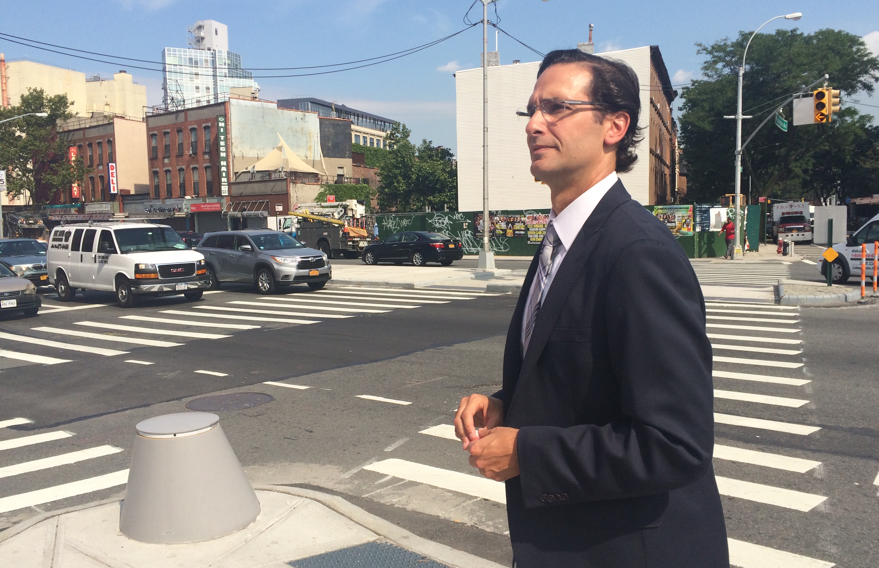 DOT Deputy Commissioner Ryan Russo talks about the latest changes to the intersection of Atlantic, Washington and Underhill avenues. Photo: Stephen Miller