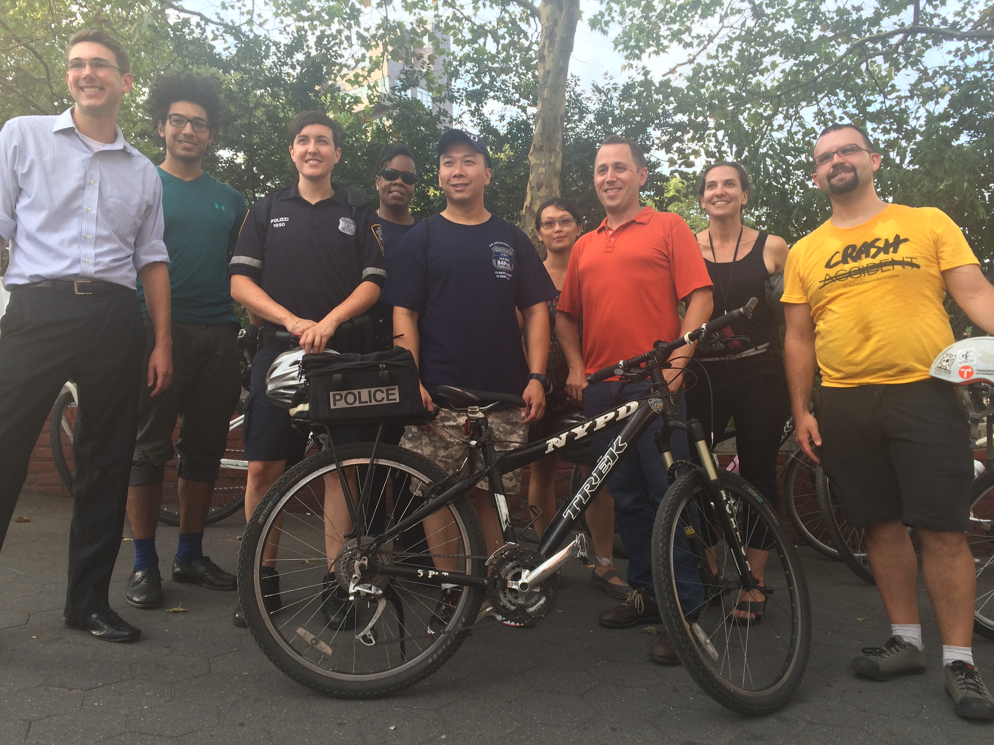 Traffic safety advocates pose with members of the Fifth Precinct before yesterday's bike ride. Photo: Stephen Miller