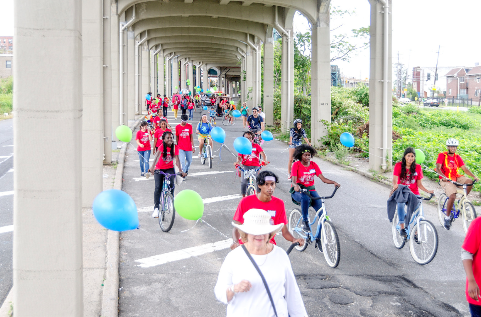 The Rockaway Bike Parade beneath the elevated train on Rockaway Freeway earlier this month. Photo: Rockaway Waterfront Alliance