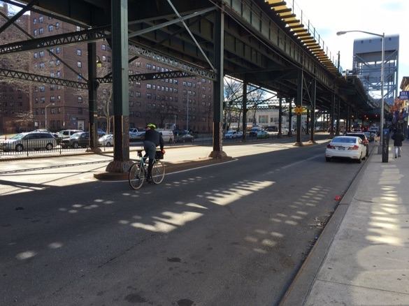 There is no bike infrastructure on Broadway, but there are pedestrian fences. Broadway Bridge in the background.
