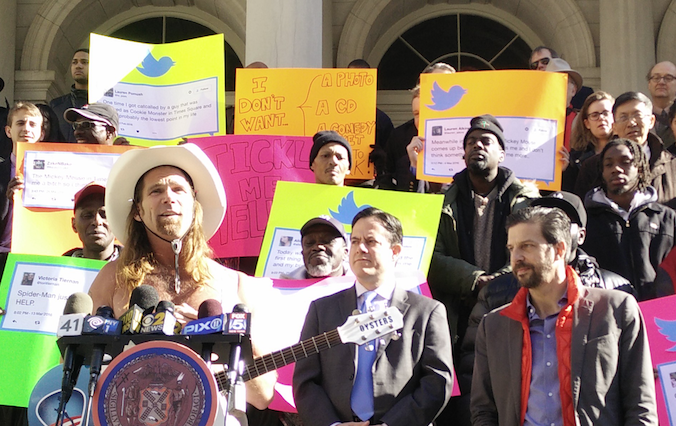 "Before today's hearing, Robert Burck, otherwise known as Times Square's famous ""Naked Cowboy,"" spoke out in favor of legislation proposed by Council Members Corey Johnson and Dan Garodnick (second from right)."