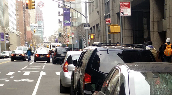 Good-bye to all that: with a protected bike lane, Jay Street will (hopefully) be rid of its notorious double-parking.