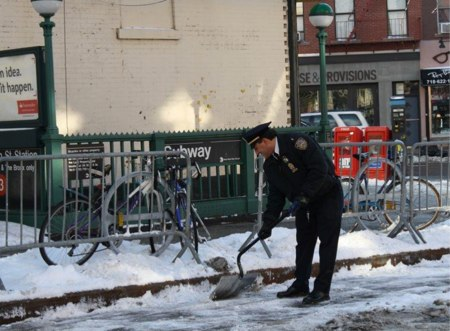 Ameri shoveling the Bergen Street bike lane in 2014. Photo: N. Wayne Bailey