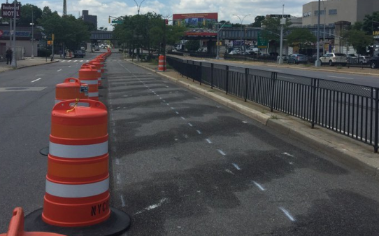 DOT has begun building out phase 2 of its safety improvements on Queens Boulevard, which include a protected bike lane. Photo: Jaime Moncayo