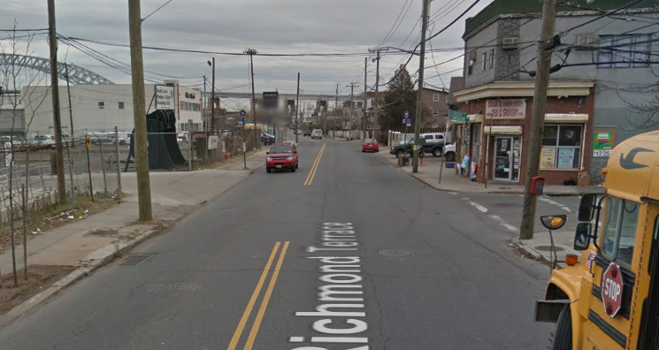 Advocates in Staten Island want safer infrastructure and better transit along the western portion of Richmond Terrace, pictured here at the intersection with Simonson Avenue where a drunk off-duty NYPD officer killed a pedestrian in 2013. Photo: Google Maps