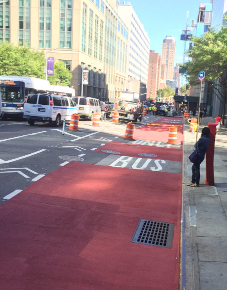 The redesign of Jay Street allows cyclists to pass around buses while remaining protected by a wide buffer zone. Photo: Brandon Chamberlin