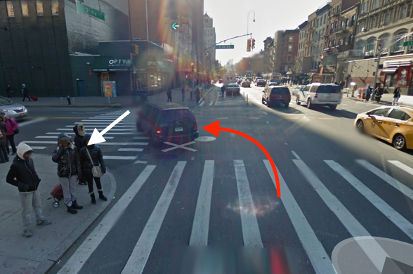 An FDNY ambulance driver turning left fatally struck Gen Zhan as he crossed E. 14th Street at Second Avenue. The white arrow represents Zhan's path, and the red arrow indicates the path of the driver. Image: Google Maps
