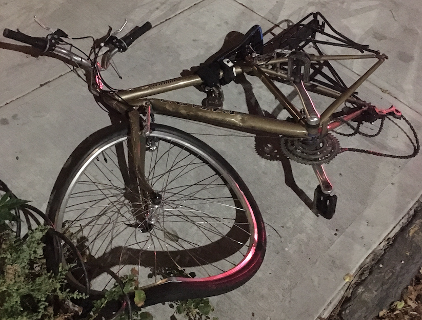 If, as NYPD says, the cyclist collided with vehicle head-on, why is the rear tired destroyed? Photo: Toby Cecchini
