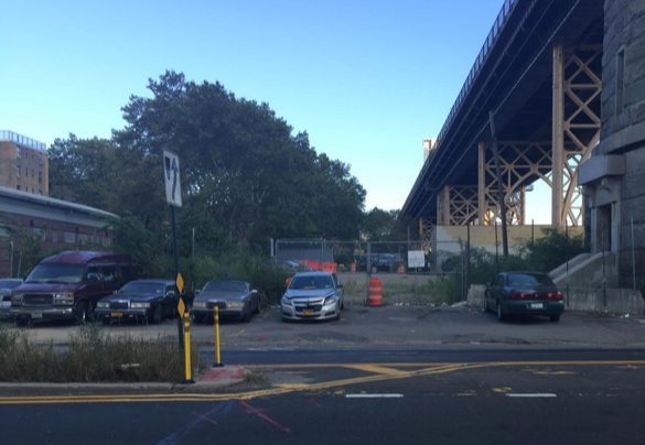 Vernon Boulevard, with Queensboro Bridge at right, is lined with illegally-parked cars, some of them apparently abandoned. Photo: David Meyer
