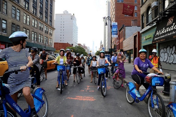 Dozens of people participated in a bike ride today to celebrate Women's Bike Month and the return of a protected bike lane on Sixth Avenue. Photos: NYC DOT
