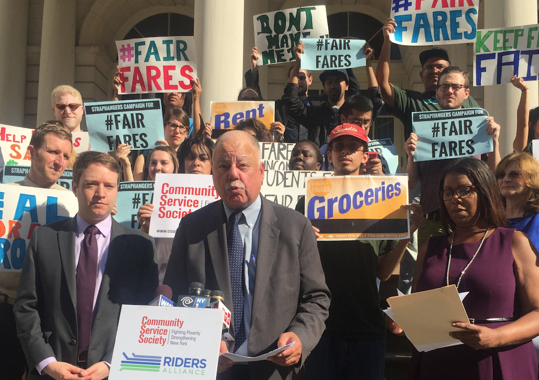 Community Service Society President David Jones (podium) speaking this morning alongside Rider Alliance Executive Direction John Raskin (left) and Public Advocate Letitia James. Photo: David Meyer
