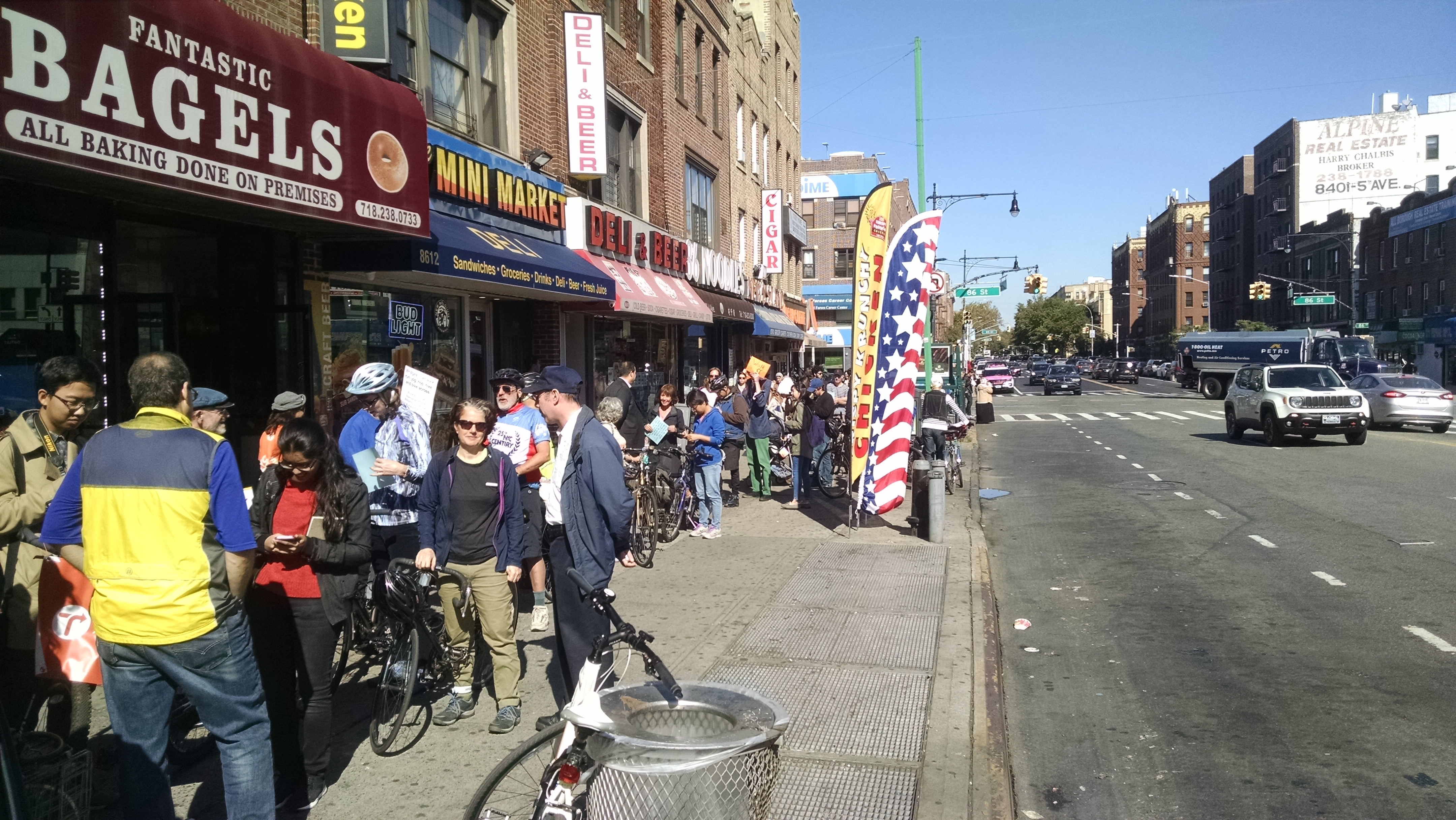 Proponents of a Verrazano Bridge biking and walking paths line up to put their bikes on MTA buses, which only hold two bikes at a time. at 4th Avenue and 86th Street in Bay Ridge on Saturday to put their bikes on bus racks (two per bus).