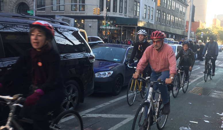 T.A. activists riding in the recently-inaugurated protected bike lane on Sixth Avenue. Photo: David Meyer