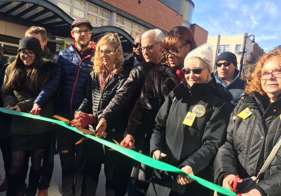 Members of Families for Safe Street and DOT staff cut the ribbon on the new plaza. Photo: David Meyer