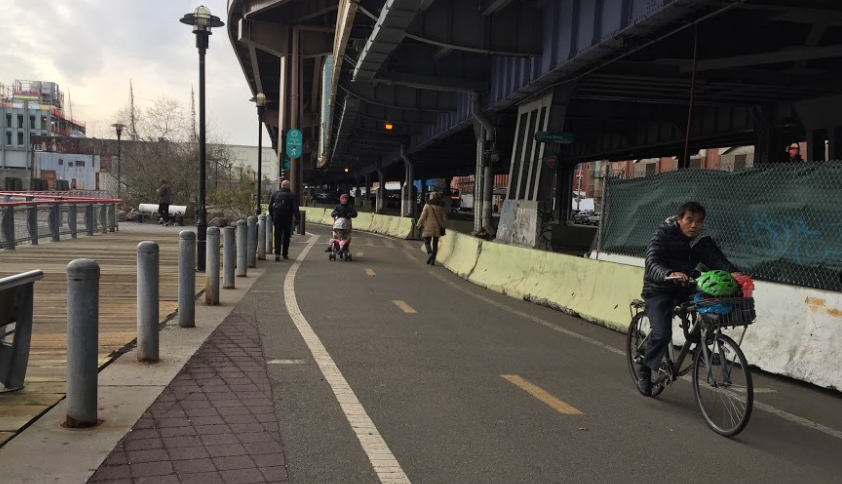 The completion of the portion of the East River esplanade to the right means cyclists and pedestrians have plenty of room. Photo: David Meyer